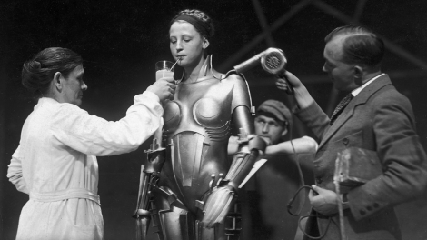 02 on the set of Fritz Lang's Metropolis — the actress inside the Maria robot taking a breather.jpg  1500×1061